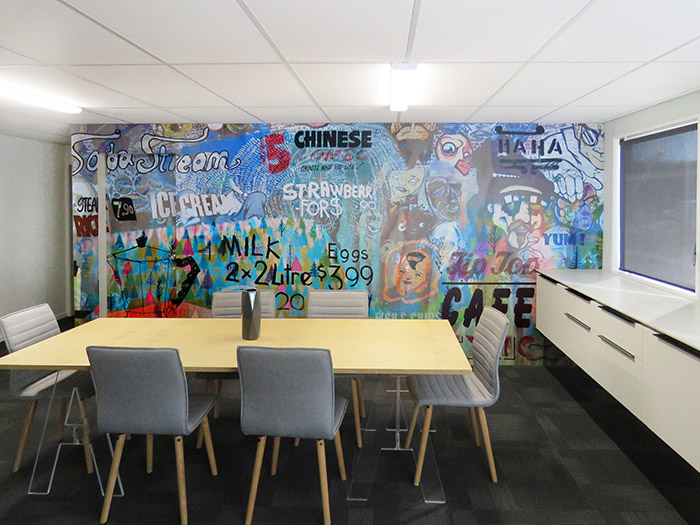 Abstract printed wallpaper photo mural featuring graffiti and collage